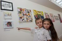 Brother and sister Will and Georgia from Kirkby enjoying looking at the Young Artist's exhibits