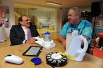 L-R Sir Bert Massie, CBE and Centre for Independent Living service user Paul Doyle testing out some of the kitchen equipment on offer at the centre