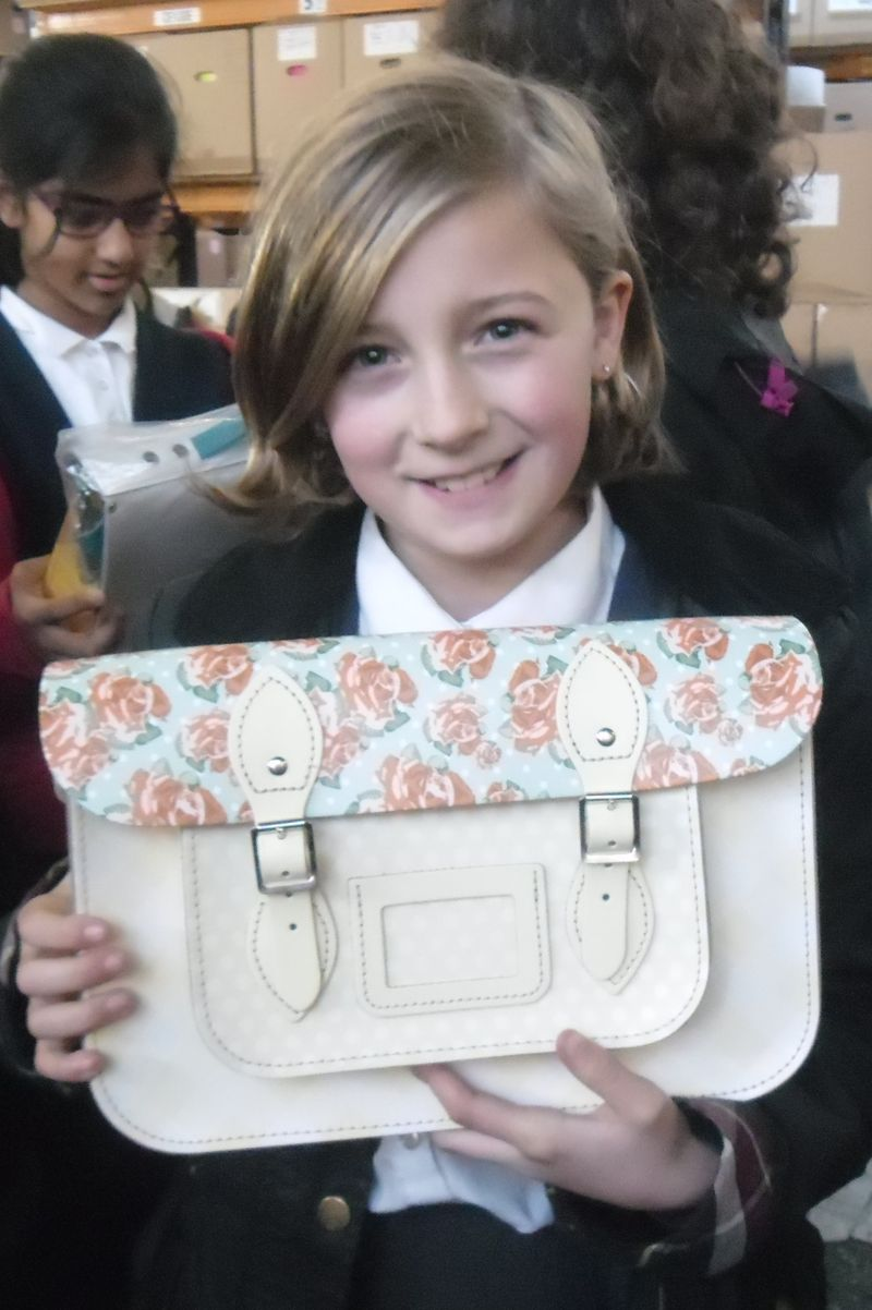 Millie Dickinson learning about satchel making
