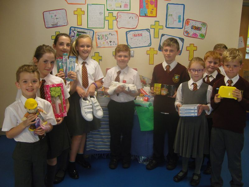 Holy Family pupils with donations for refugees